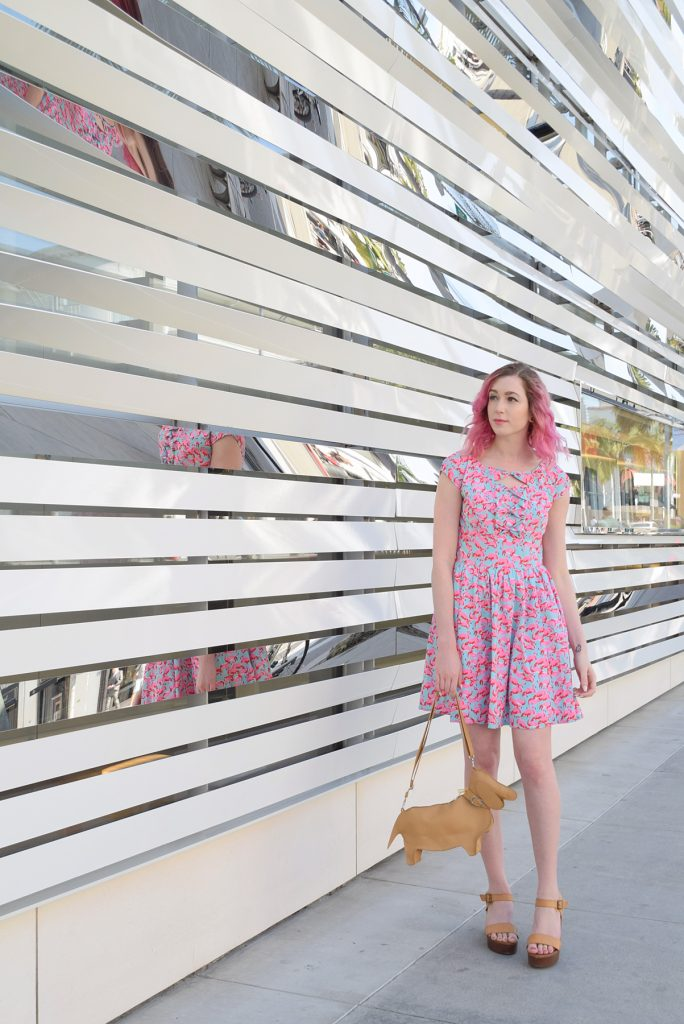 Flamingos and Dachshunds, a fashion post with Los Angeles Cruelty-Free Beauty Blogger, Emily Wolf Beauty. eshakti FLAMINGO PRINT BOW FRONT CREPE DRESS, chopin roma dachshund purse, forever21 tan leather platform sandals
